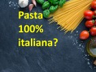 Spaghetti, tomatoes and others ingrdients for italian pasta on blackboard