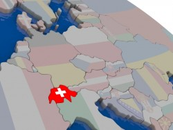 Switzerland with flag highlighted on model of globe. 3D illustration