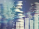 Double exposure of city and graph on rows of coins