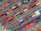 Container ship in export and import business logistics and transportation. Cargo and container box shipping to harbor by crane. Water transport International. Aerial view and top view.